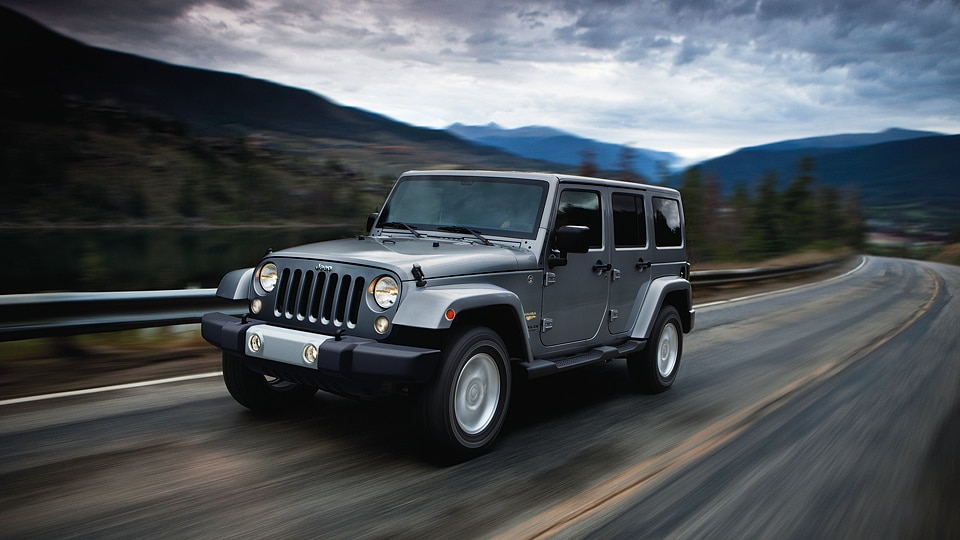 Silver Jeep Wrangler Unlimited tackling an adventure near Anchorage, AK