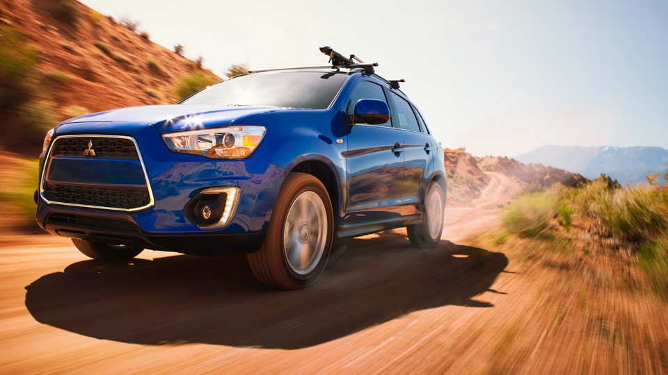 Mitsubishi Outlander Sport SUV driving up road