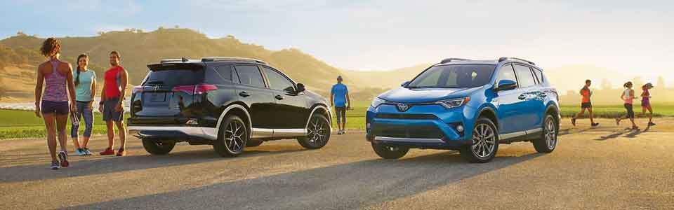 two parked 2016 Toyota RAV4 SUVs