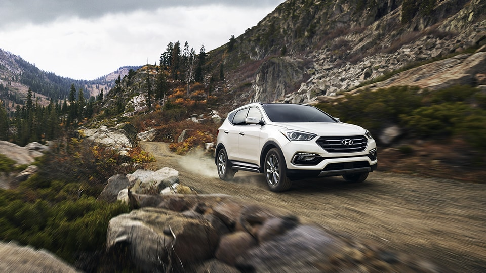 Hyundai Santa Fe Sport on dirt road