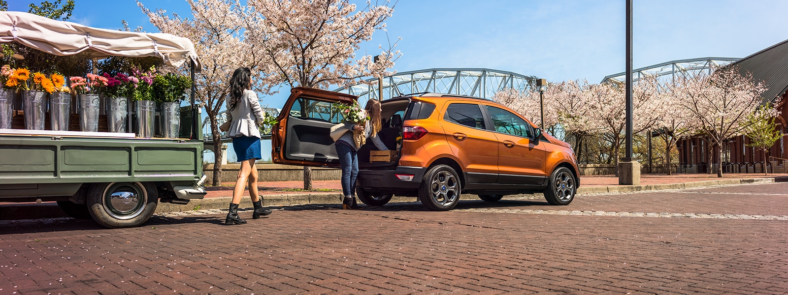 Ladies taking flowers out of the back of the 2018 Ford EcoSport Crossover