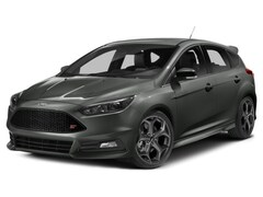 Used 2015 Ford Focus ST WITH NAVIGATION HATCHBACK Hatchback 1FADP3L9XFL309514 for sale in Calgary, Alberta