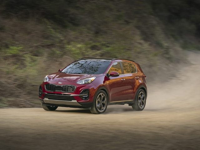 West Broad Kia is a Kia Dealership in Richmond, VA | 2021 Kia Sportage driving on dirt road