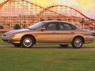 Pre-Owned 1999 Ford Taurus Sedan 1FAFP53U3XG234979 for Sale in Bend, OR