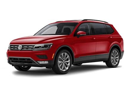 https://images.dealer.com/ddc/vehicles/2018/Volkswagen/Tiguan/SUV/trim_20T_S_86fd2d/color/Cardinal%20Red%20Metallic-7H7H-137%2C17%2C32-640-en_US.jpg?impolicy=downsize&w=440