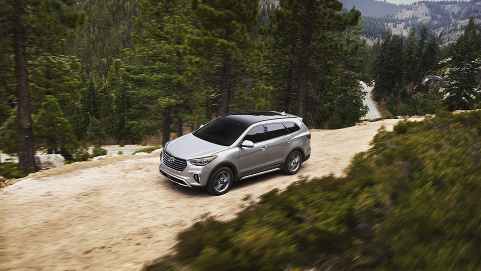 Hyundai Santa Fe SUV on mountain terrain