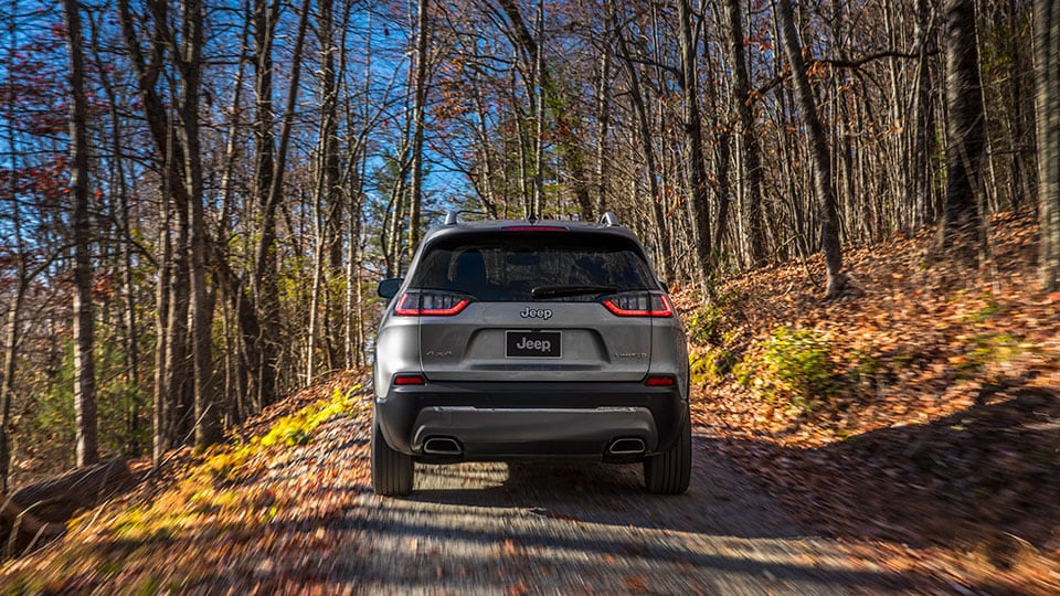 2021 Jeep Cherokee Driving On Road In Fall