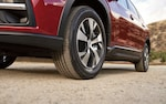 A close-up of the 8.7 inches of ground clearance on the Subaru Ascent.