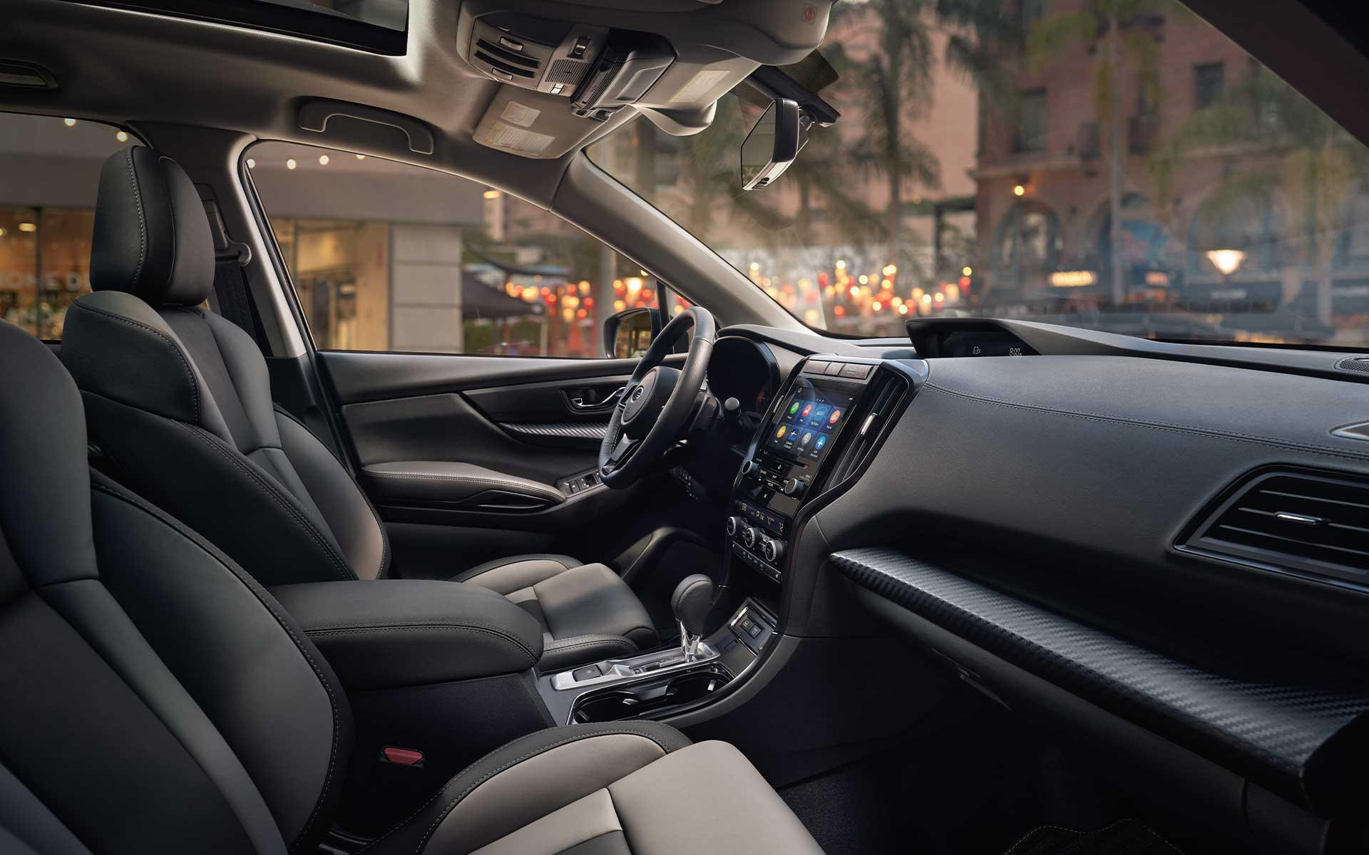 A view of the front seats showing the upgraded interior of the Subaru Ascent Onyx Edition.