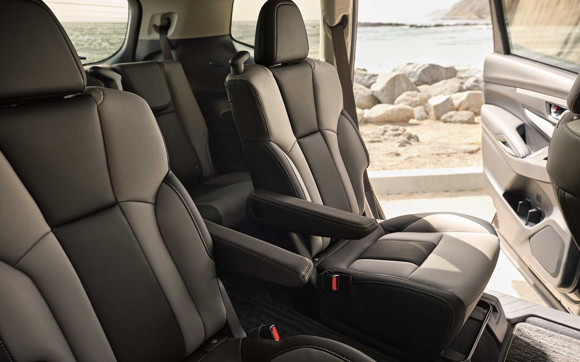 A view of the rear seats showing the gray StarTex Upholstery inside the Subaru Ascent Onyx Edition.