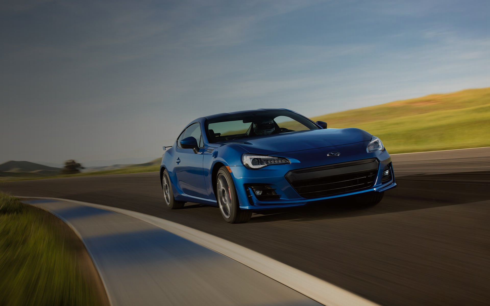 A 2020 BRZ cornering on a race track.