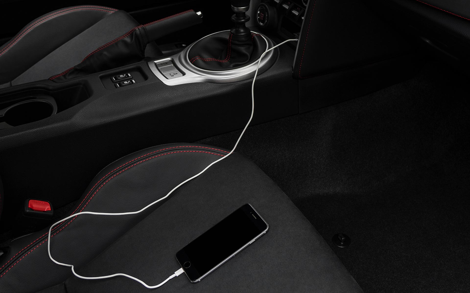 A close-up of a smartphone plugged into one of the dual USB ports on the 2020 BRZ.