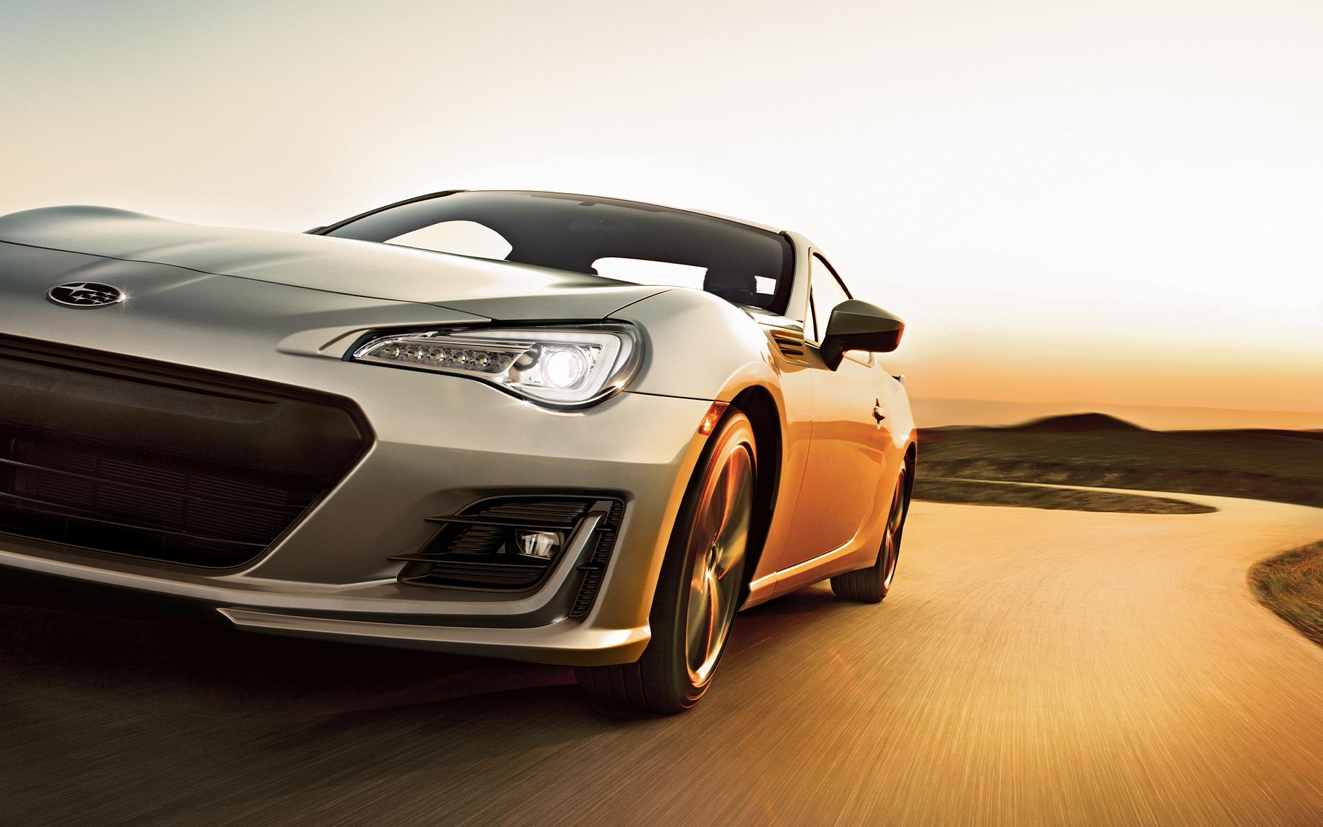 A 2020 BRZ driving at sunset.