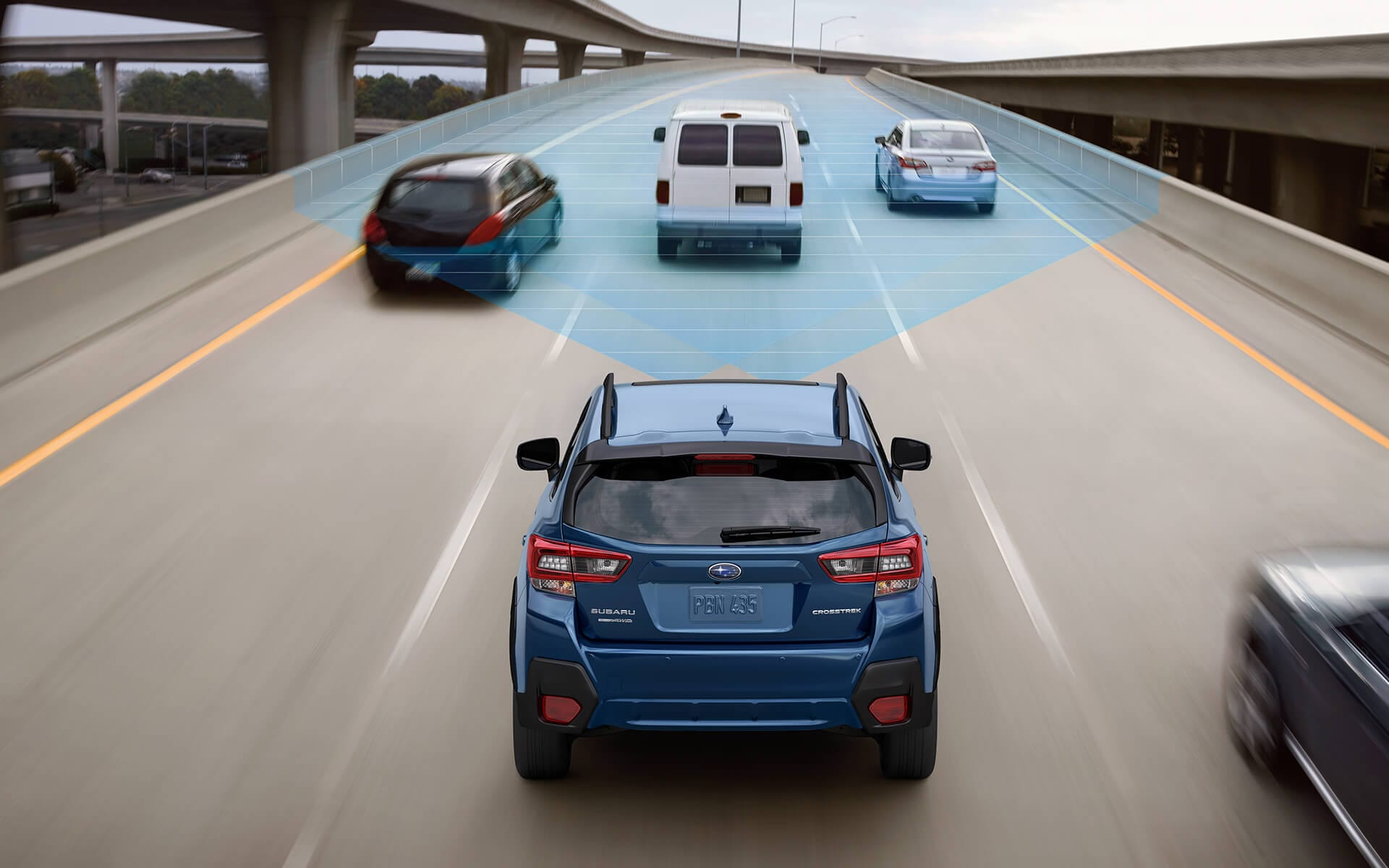 A 2020 Crosstrek driving on a freeway with the EyeSight® Driver Assist Technology sensors illustrated with blue overlay.