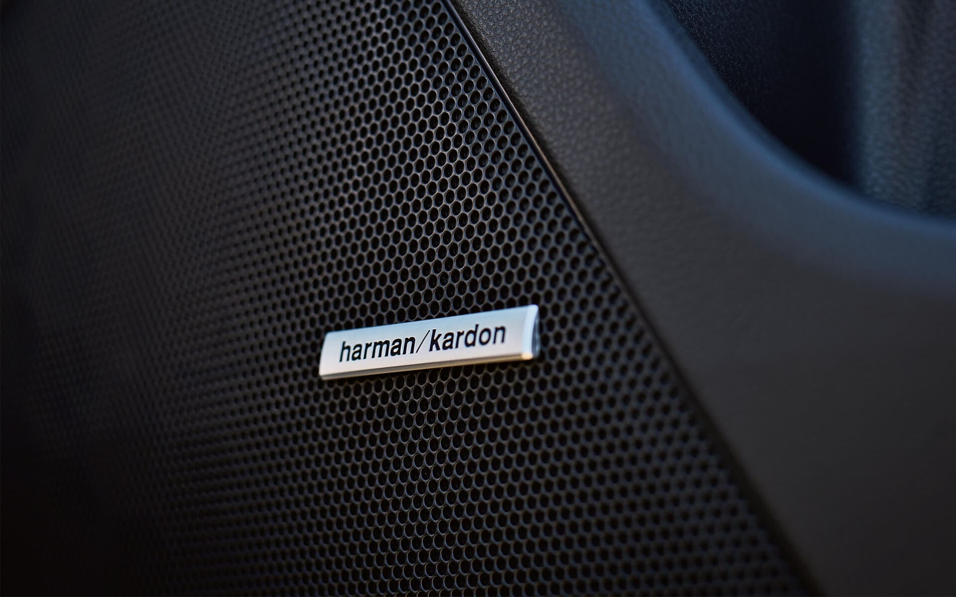 A close-up of a Harman Kardon Premium Audio speaker in the 2020 Crosstrek.