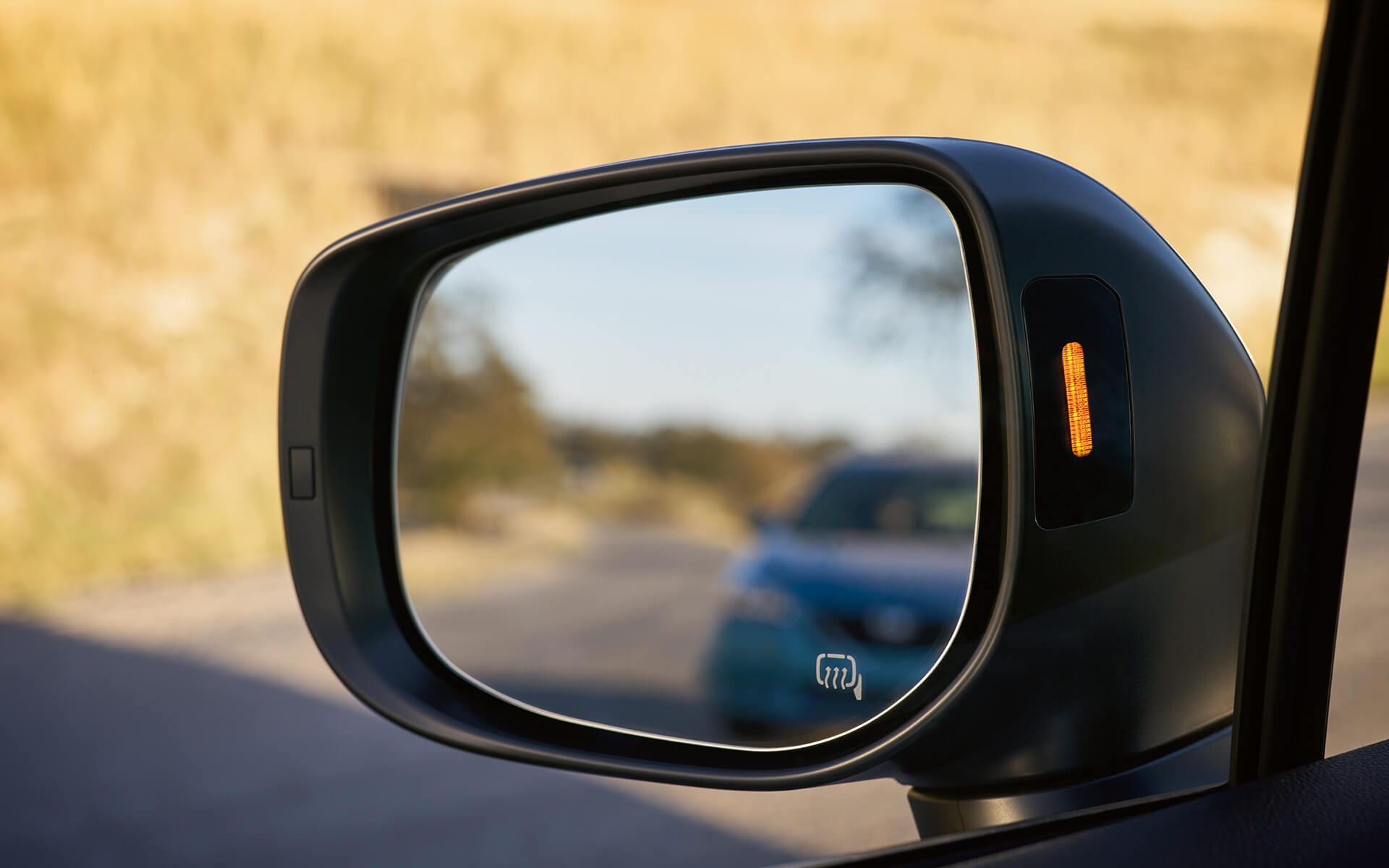 A close-up of a Blind-Spot Detection indicator light on the 2020 Crosstrek side mirror.
