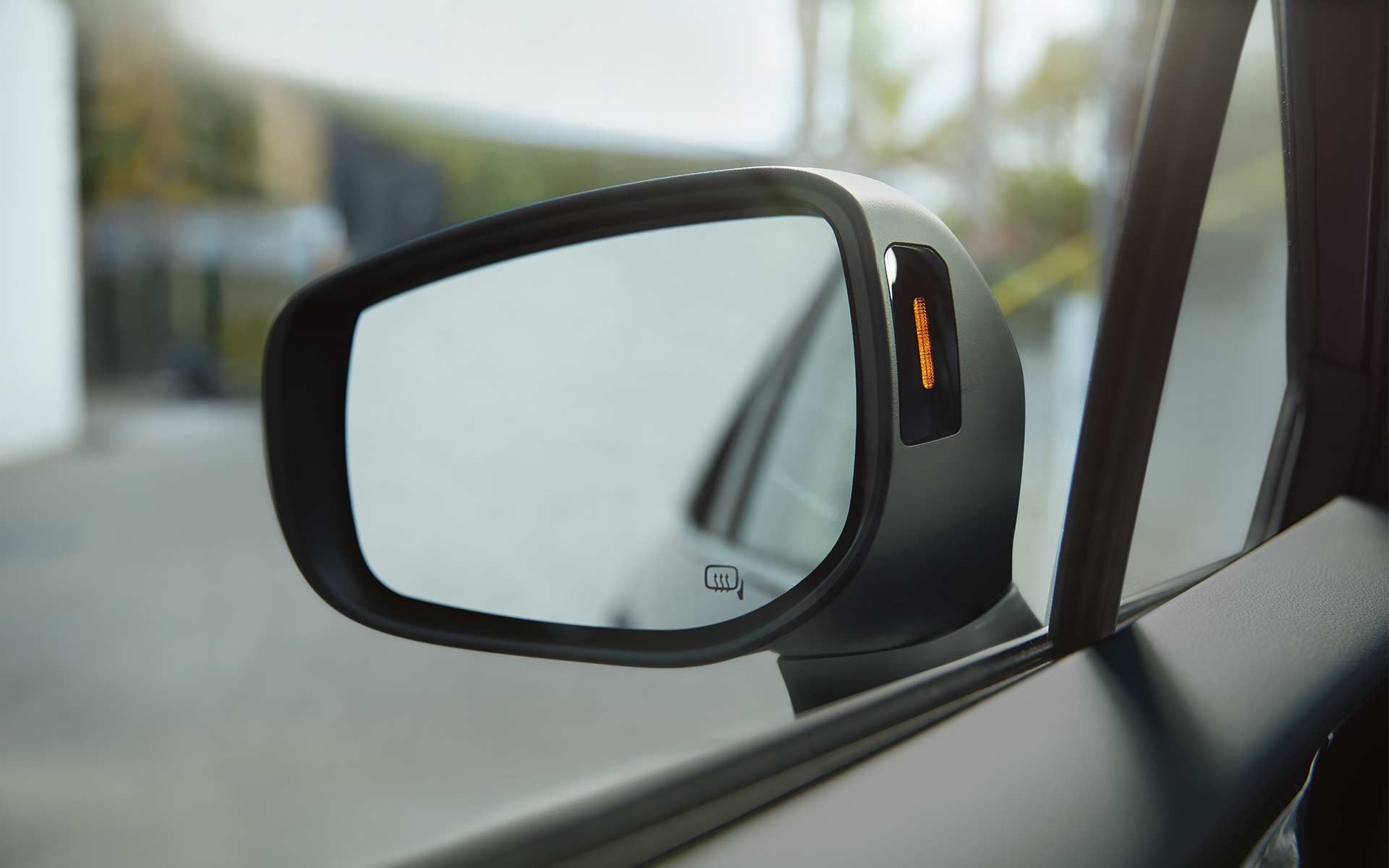 A close-up of a Blind-Spot Detection visual indicator in the side mirror of a 2020 Impreza.