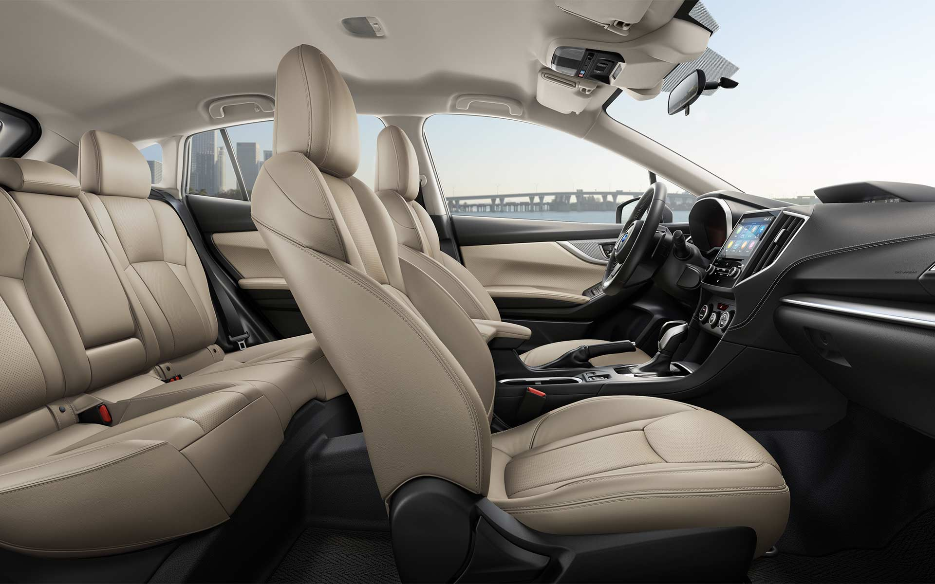 An interior photo showing the front and rear seats of the 2020 Impreza.