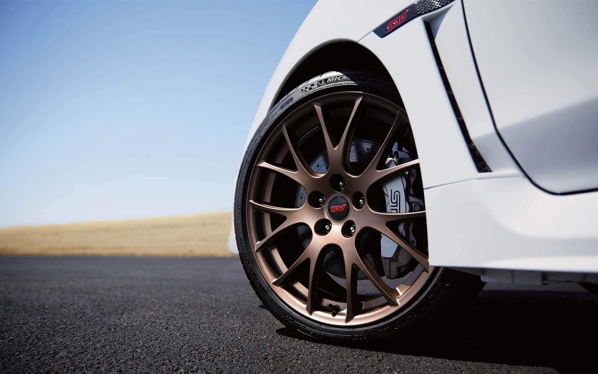 Close up view of Subaru WRX STI Series.White wheel