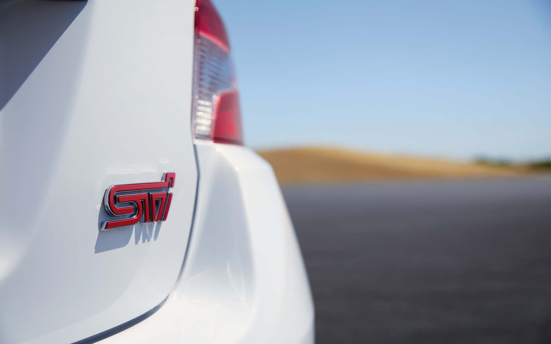 Close up view of Subaru WRX STI Series.White rear STI badge