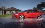 A 2022 Impreza sedan driving through a rain storm.