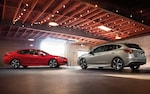 A photo of a 2022 Impreza 5-door and sedan parked in a garage.