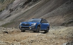 2022 Outback Wilderness in Geyser Blue parked on a rocky road.