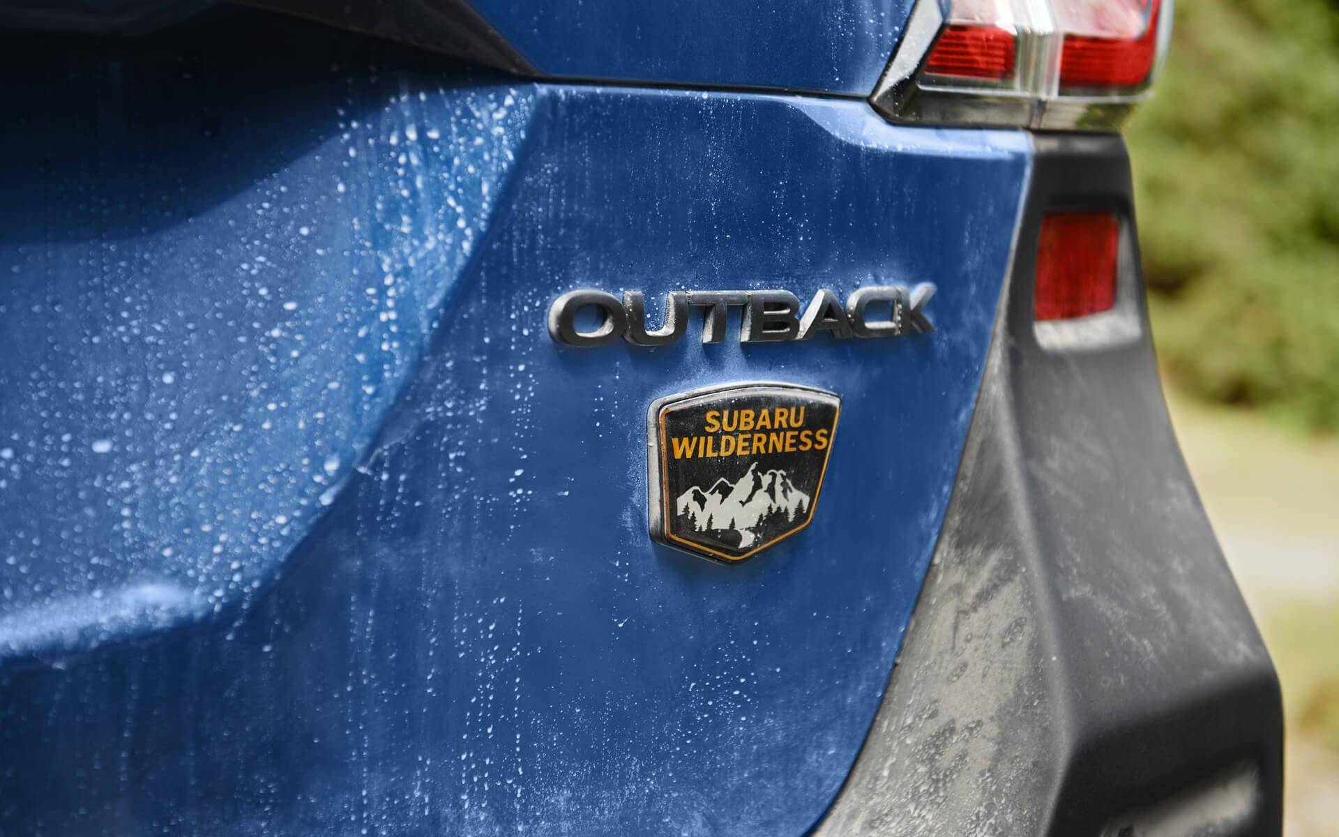 A close up of the 2022 Subaru Outback Wilderness badge on the back bumper.