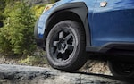 A close-up of the wheels of the 2022 Outback Wilderness showing the 9.5 inches of ground clearance.