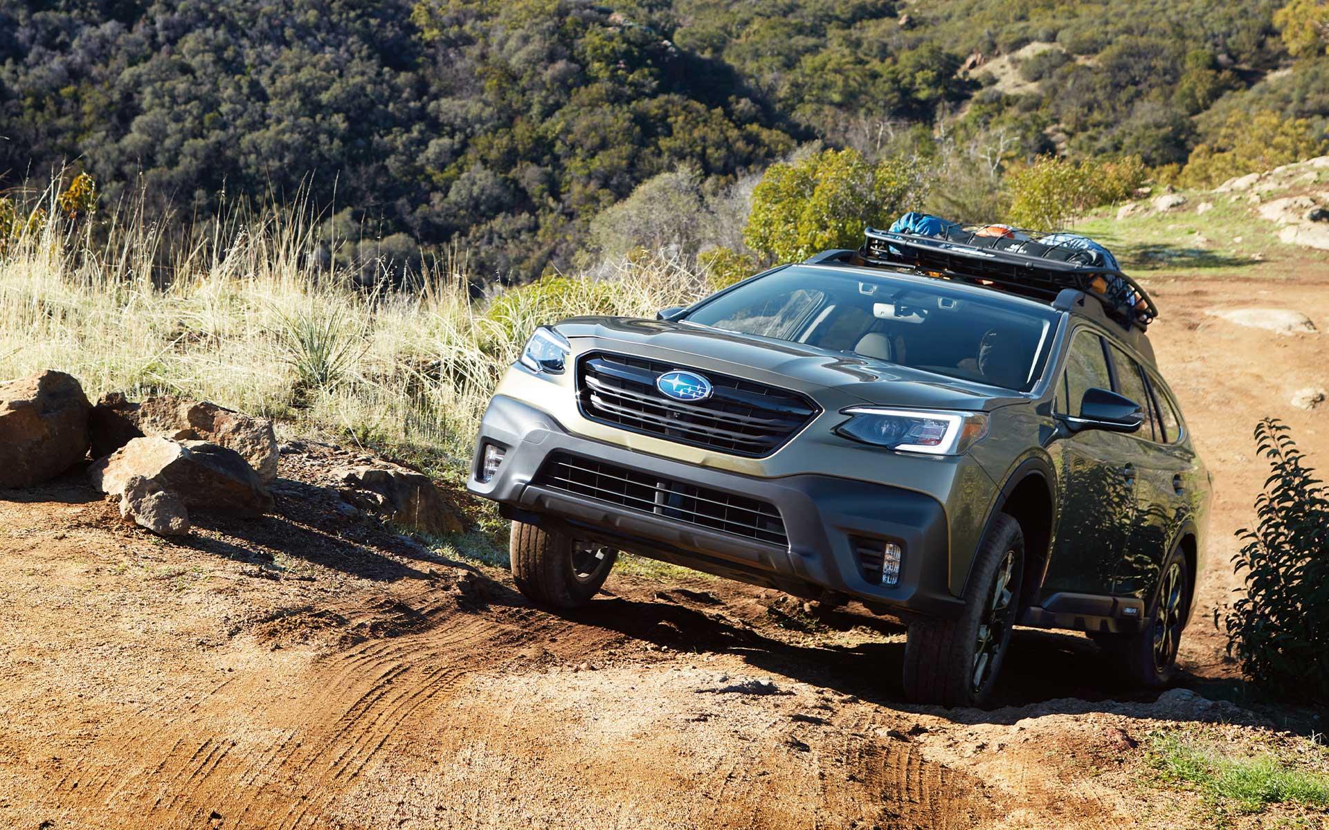 A 2022 Subaru Onyx Edition XT climbing a steep dirt road.