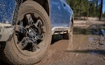 A Subaru Outback with a dirty wheel